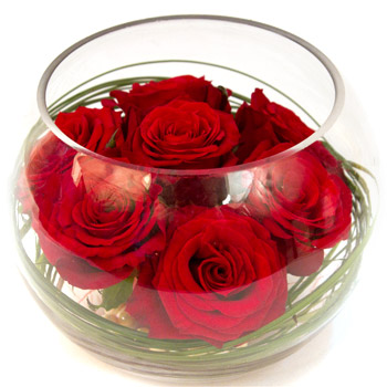 Vase with red roses inside